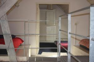 A bunk bed or bunk beds in a room at Loft ça suffit, Eddy!