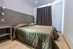A bed or beds in a room at Residence Club Marina Viva