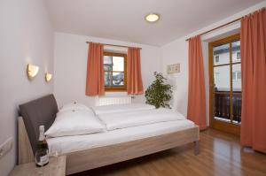 Postel nebo postele na pokoji v ubytování Appartementhaus Erasim