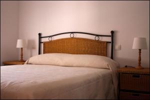 Cama o camas de una habitación en Apartamentos Barrena