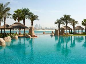 The swimming pool at or near Sofitel Dubai Palm Apartments