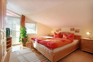A bed or beds in a room at Appartement Irmgard