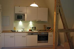 A kitchen or kitchenette at Haus am See