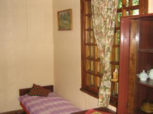 A bed or beds in a room at Vācu Nams