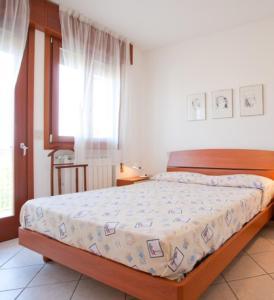 Postel nebo postele na pokoji v ubytování Residence Benidorm
