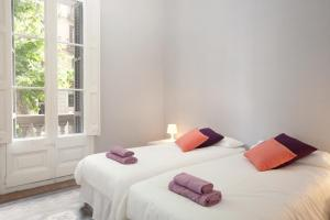A bed or beds in a room at Modernist Apartment Barcelona