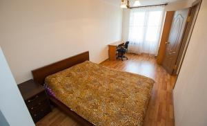 A bed or beds in a room at Business Brusnika Apartments Sokol