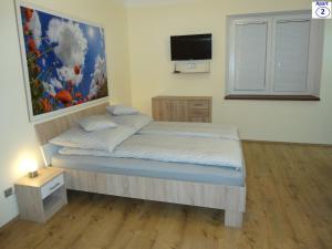 Кровать или кровати в номере Sibiu-Heim-Apart
