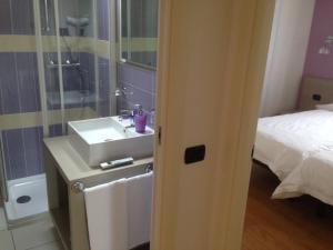 Ein Badezimmer in der Unterkunft Residence CaFelicita