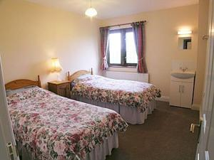 A bed or beds in a room at Canon Court Farm