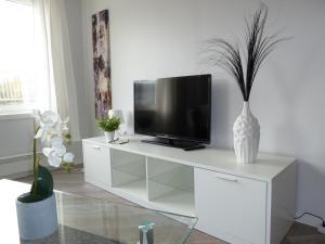TV/Unterhaltungsangebot in der Unterkunft Lilland Hotell Apartments
