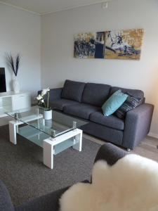 Ein Sitzbereich in der Unterkunft Lilland Hotell Apartments