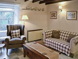 A seating area at Brig Of Tig Cottage