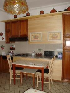 A kitchen or kitchenette at Bellagio Center Apartment n°12