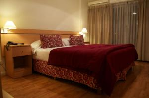 A bed or beds in a room at Apart San Diego Recoleta