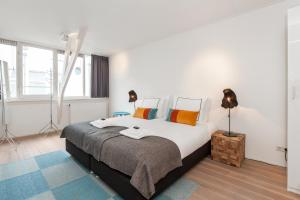 A bed or beds in a room at Cityden Old South Serviced Apartments