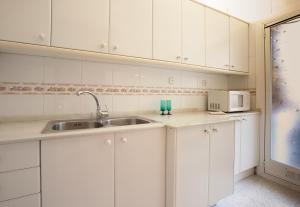A kitchen or kitchenette at Gracia NextDoor 2