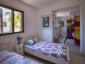 A bed or beds in a room at Marie Villa