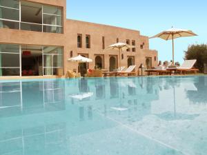 The swimming pool at or near Villa Loanaelle