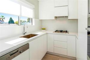 A kitchen or kitchenette at Bondi Executive - A Bondi Beach Holiday Home