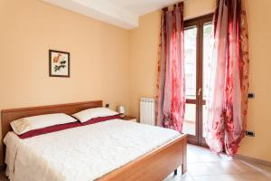 A bed or beds in a room at Al Rivobello