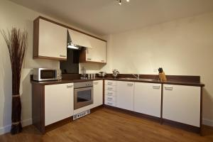 A kitchen or kitchenette at Exchange Building Apartments by esa