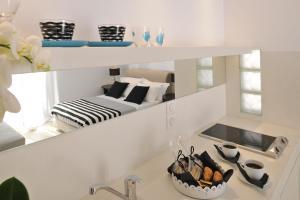 A kitchen or kitchenette at Romantica Suites