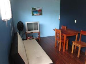 A television and/or entertainment center at Axios Sun Apartments Caye Caulker