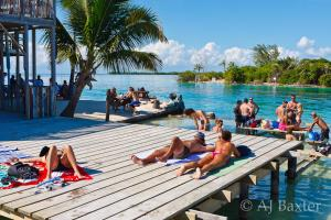A family staying at Axios Sun Apartments Caye Caulker
