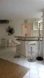 A kitchen or kitchenette at Ferienwohnung Bella