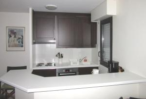 A kitchen or kitchenette at Appartements Blonville Centre (2 ou 3 chambres)