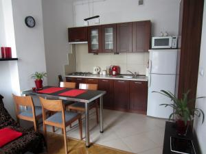 A kitchen or kitchenette at Unique Warsaw Center Apartment