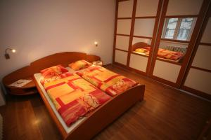 A bed or beds in a room at Apartments Bratislava - Jakubovo Square