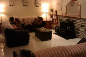 A seating area at Martinville Self Catering Holiday Home