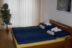 A bed or beds in a room at Apartmán Mickiewiczova