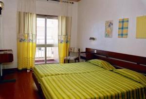 Postel nebo postele na pokoji v ubytování Hotel Apartamento Iate