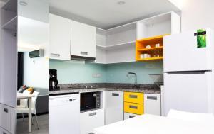 A kitchen or kitchenette at Green Garden Suites Hotel