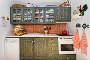 A kitchen or kitchenette at 3Arches