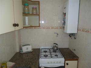 A kitchen or kitchenette at Departamento Ficha 14