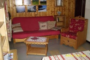 "A seating area at Chalet ""Sous l'saix"""