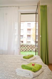 Postel nebo postele na pokoji v ubytování Semiramis Apartment