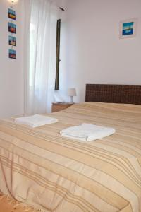 A bed or beds in a room at Holiday Home Rovinj Savicenti