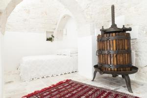 Un pat sau paturi într-o cameră la Trulleria Tagliente
