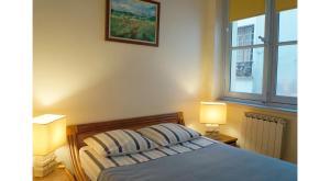 A bed or beds in a room at Le 38, rue Saint-Louis en l'île
