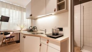 A kitchen or kitchenette at Room For Rent