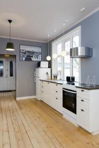 A kitchen or kitchenette at Old Charm Reykjavik Apartments