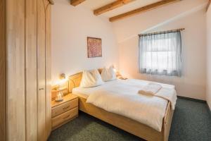 Ein Bett oder Betten in einem Zimmer der Unterkunft Residence Pfeifhofer