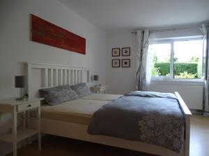 Ein Bett oder Betten in einem Zimmer der Unterkunft Ferienwohnung Findus