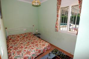 A bed or beds in a room at Villa Bugamvilla