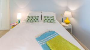 A bed or beds in a room at Bubali Bliss Studios